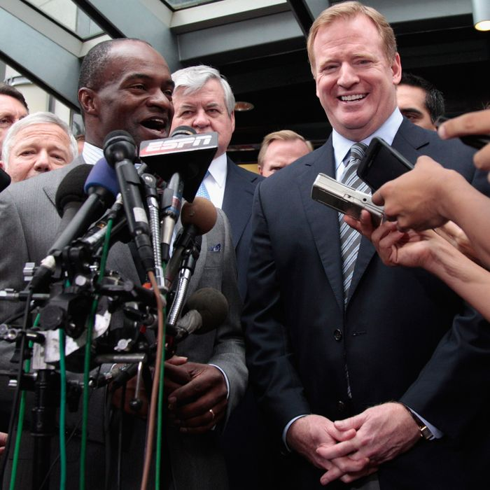 WASHINGTON, DC - JULY 25: DeMaurice Smith (L) executive director of the National Football League Players' Association and NFL commissioner Roger Goodell (R) address the the media on July 25, 2011 in Washington, DC. The NFL players and owners announced they have reached agreement and ended the lockout. (Photo by Rob Carr/Getty Images)