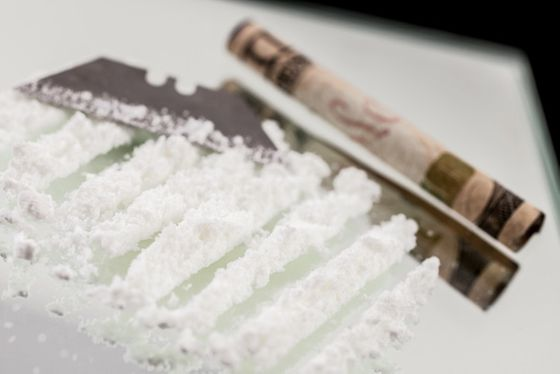 """Cocaine,"" served with a razor blade and a straw. It's actually flavored powders Foss got from Terra Spice, and so far, Foss says, no one's actually tried to snort it. ""Up to this point it's been kind of these classic dishes from the 80s, and everyone's pretty quiet. Then I come out with powder on my face and go, 'Whoa, this is fucking awesome,' and suddenly the whole room is noisy and wild for the rest of the meal."""