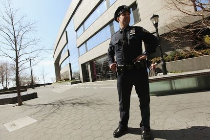 A New York Police Department officer keeps watch outside the Museum of Jewish Heritage in Manhattan on March 20, 2012 in New York City. Extra security has been added to Jewish sites around the city following the attack on a Jewish school in France that killed four people.