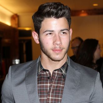 NEW YORK, NY - SEPTEMBER 09: Nick Jonas attends an Evening By Sherri Hill fashion show during Mercedes-Benz Fashion Week Spring 2014 at Trump Tower on September 9, 2013 in New York City. (Photo by Monica Schipper/Getty Images)