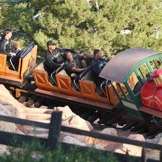 Players from the University of Oregon Ducks celebrating the 98th Rose Bowl Game ride Big thunder Mountain Railroad at Disneyland park on December 27, 2011 in Anaheim, California.