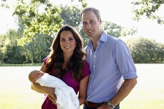 In this handout image provided by Kensington Palace, Catherine, Duchess of Cambridge and Prince William, Duke of Cambridge pose for a photograph with their son, Prince George Alexander Louis of Cambridge in the garden of the Middleton family home in August 2013 in Bucklebury, Berkshire.