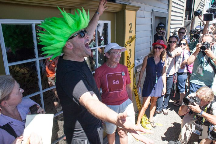 Jeremy Cooper (L) waits with Deb Greene (R), who was first in line to enter Cannabis City, a retail marijuana store, on July 8, 2014 in Seattle, Washington. Cannabis City was the first retail marijuana store to open in Seattle on July 8 and one of many now operating in Washington state, nearly a year and a half after the state's voters chose to legalize marijuana.