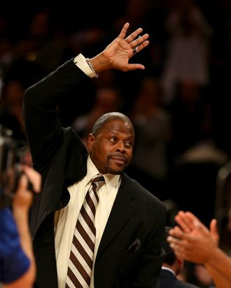 New York Knicks legend Patrick Ewing salutes the fans in the first quarter at Madison Square Garden on November 5, 2013 in New York City.Ewing is now an assistant coach on the Charlotte Bobcats.