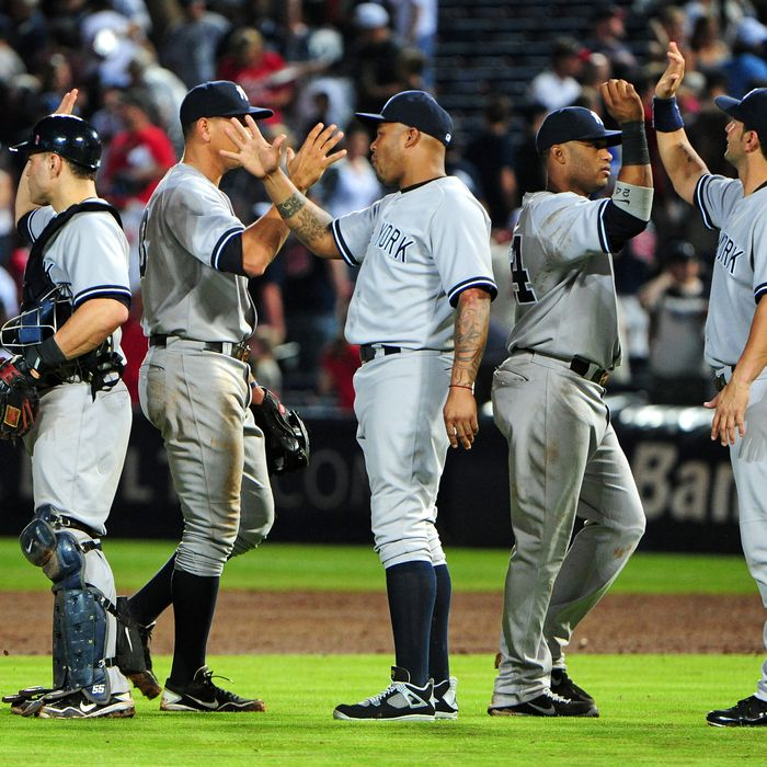 Members of the New York Yankees celebrate after the game against the Atlanta Braves at Turner Field on June 13, 2012 in Atlanta, Georgia.