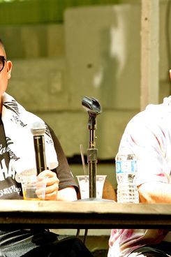 "Chefs Eddie Huang (L) and Tom Colicchio speak during ""Noshing With..."" at the Great Googa Mooga 2012 at Prospect Park on May 20, 2012 in the Brooklyn borough of New York City."