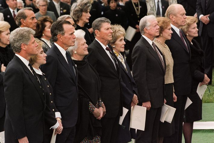US President Bill Clinton (L) and First Lady Hillary Clinton (2ndL) are joined by four former presidents and their wives, 27 April 1994, during former President Richard Nixon's funeral in Yorba Linda, California. (L-R) President George Bush and Barbara Bush, President Ronald Reagan and Nancy Reagan, President Jimmy Carter and Rosalynn Carter, President Jerry Ford and Betty Ford. (Photo credit should read LUKE FRAZZA/AFP/Getty Images)