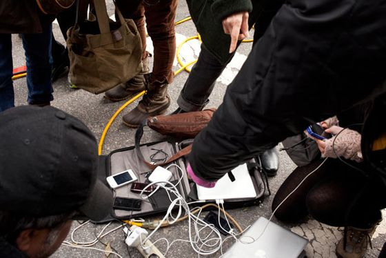 People charging their devices at 8th Avenue between 15th and 14th Streets, October 31.