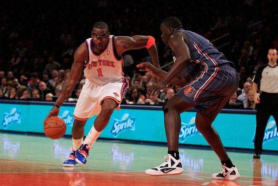 NEW YORK, NY - JANUARY 09:  (L) Amare Stoudemire #1 of the New York Knicks dribbles past (R) DeSagana Diop #7 of the Charlotte Bobcats at Madison Square Garden on January 9, 2012 in New York City. NOTE TO USER: User expressly acknowledges and agrees that, by downloading and or using this photograph, User is consenting to the terms and conditions of the Getty Images License Agreement.  (Photo by Chris Trotman/Getty Images)
