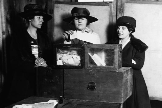ca. 1920s --- Three women vote at a polling station in New York City, New York, USA. --- Image by ? CORBIS