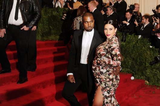 "NEW YORK, NY - MAY 06:  Kanye West and Kim Kardashian attend the Costume Institute Gala for the ""PUNK: Chaos to Couture"" exhibition at the Metropolitan Museum of Art on May 6, 2013 in New York City.  (Photo by Dimitrios Kambouris/Getty Images)"