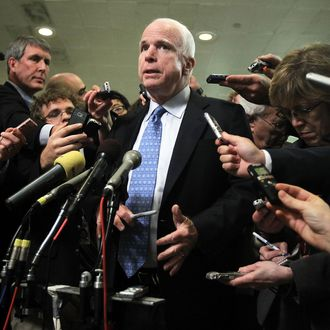 U.S. Sen. John McCain (R-AZ) speaks to members of the media after a hearing on the Benghazi attack before the Select Committee on Intelligence November 16, 2012 on Capitol Hill in Washington, DC. Former Central Intelligence Agency (CIA) Director David Petraeus testified before the committee about the September 11 attacks on the American diplomatic compound in Benghazi, Libya, that killed Ambassador Christopher Stevens and three other Americans.