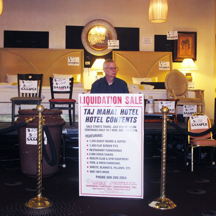 An Employee Of A Liquidation Company Waits For Customers At The Former  Trump Taj Mahal Casino In Atlantic City, New Jersey, On Thursday July 6,  2017, ...
