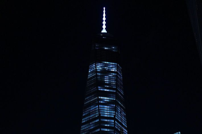 NEW YORK, NY - MAY 19: The Freedom Tower is viewed at the Ground Zero memorial site after authorities recently took down gates and opened the plaza to the public on May 19, 2014 in New York City. Visitors previously had to wait in line to enter a barricaded area which includes the newly dedicated National September 11 Memorial Museum. Together with the museum, Ground Zero has become one of the top tourist attractions in the nation with tens of thousands of visitors expected yearly.  The museum will open to the general public this Wednesday.  (Photo by Spencer Platt/Getty Images)