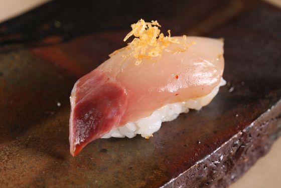 Kampachi (baby yellowtail) with spicy potato.