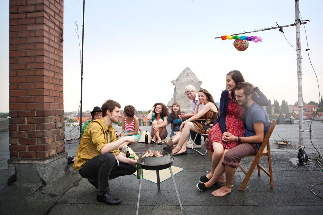 Friends having rooftop cookout