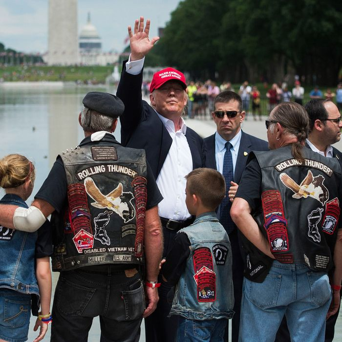 Republican presedential candidate Donald Trump waves to veterans and supporters after an event at the annual Rolling Thunder