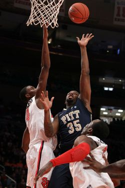 NEW YORK, NY - MARCH 06:  Nasir Robinson #35 of the Pittsburgh Panthers puts up a shot against Moe Harkless #4 of the St. John's Red Storm during their first round game of the 2012 Big East Men's Basketball Tournament at Madison Square Garden on March 6, 2012 in New York City.  (Photo by Jim McIsaac/Getty Images)