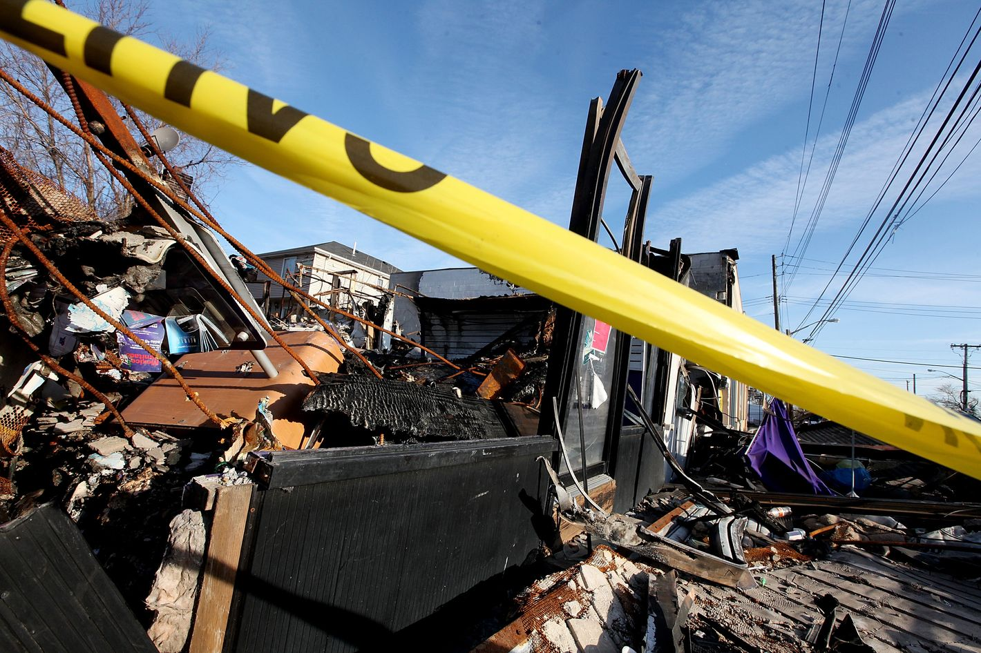 A property destroyed by fire following Superstorm Sandy remains blocked by police tape in the Midland Beach neighborhood which was heavily damaged by Sandy on December 23, 2012 in the Staten Island borough of New York City. Staten Island was hit hard by Sandy and some homes and businesses remain without power.