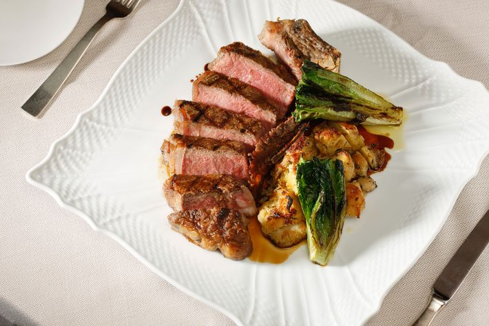 Marea's tagliata with grilled romaine and bone-marrow panzanella.