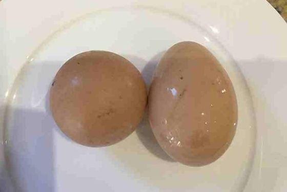 Next to a regular egg, for contrast.