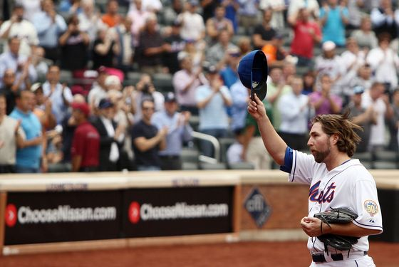 R.A. Dickey #43 of the New York Mets acknowledges the crowd after being pulled in the eighth inning against the Pittsburgh Pirates at Citi Field on September 27, 2012 in the Flushing neighborhood of the Queens borough of New York City.