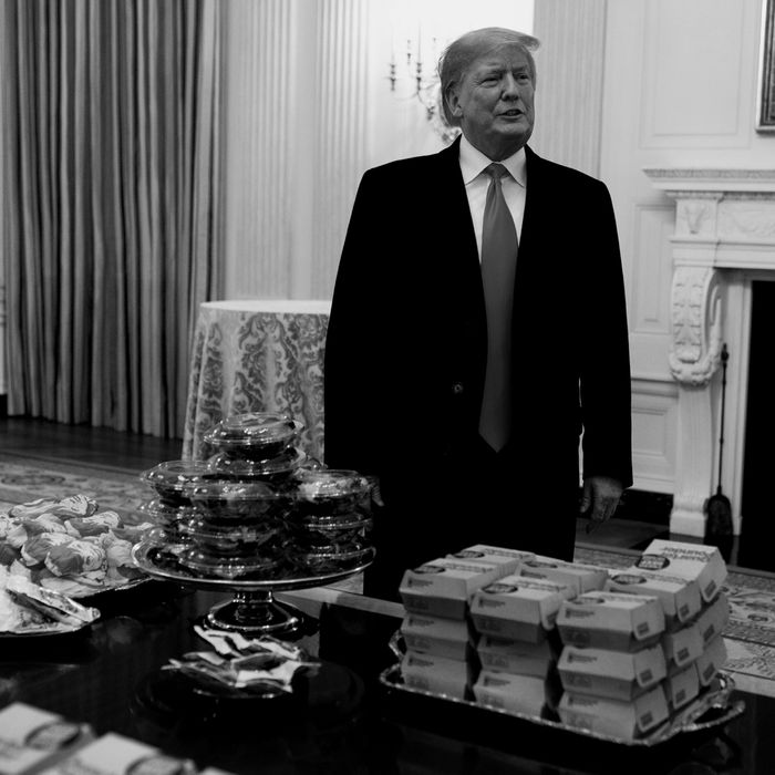 President Trump in behind a pile of fast food.