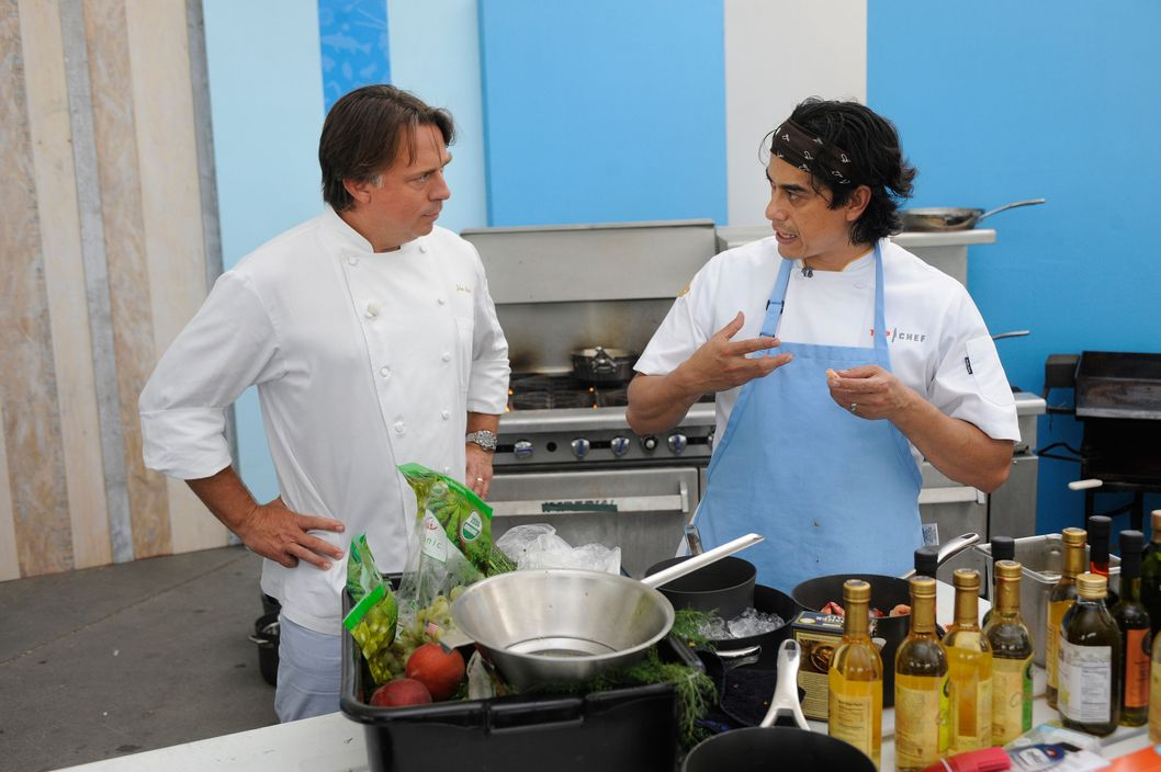 "TOP CHEF -- ""Mississippi Mud Bugs"" Episode 1112 -- Pictured: (l-r) John Besh, Carlos Gaytan -- (Photo by: David Moir/Bravo)"