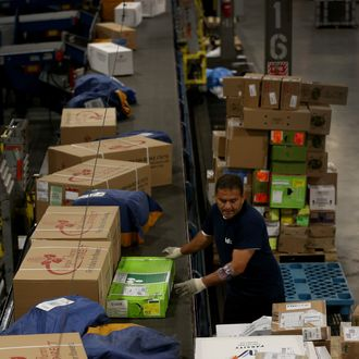MIAMI, FL - DECEMBER 02: FedEx employee, Juan Alvarez, sorts through packages at a shipping center that are heading out for delivery on Cyber Monday on December 2, 2013 in Miami, Florida. With the holiday shopping season starting and more holiday shoppers expected to use the internet, FedEx is expected to make 22 million shipments around the world Monday, an 11 percent year-over-year increase. The company expects to make more than 85 million shipments through Saturday. (Photo by Joe Raedle/Getty Images)