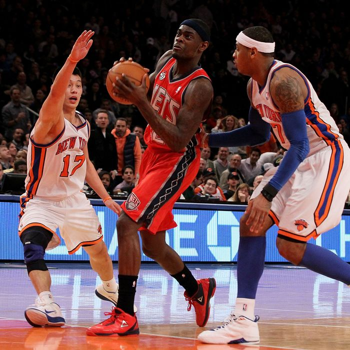 Anthony Morrow #22 of the New Jersey Nets in action against Jeremy Lin #17 and Carmelo Anthony #7 of the New York Knicks
