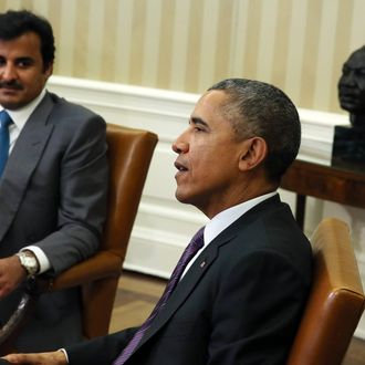 U.S. President Barack Obama (R) meets with Amir of Qatar, His Highness Sheikh Tamim bin Hamad al Thani in the Oval Office of the White House February 24, 2015 in Washington, DC.