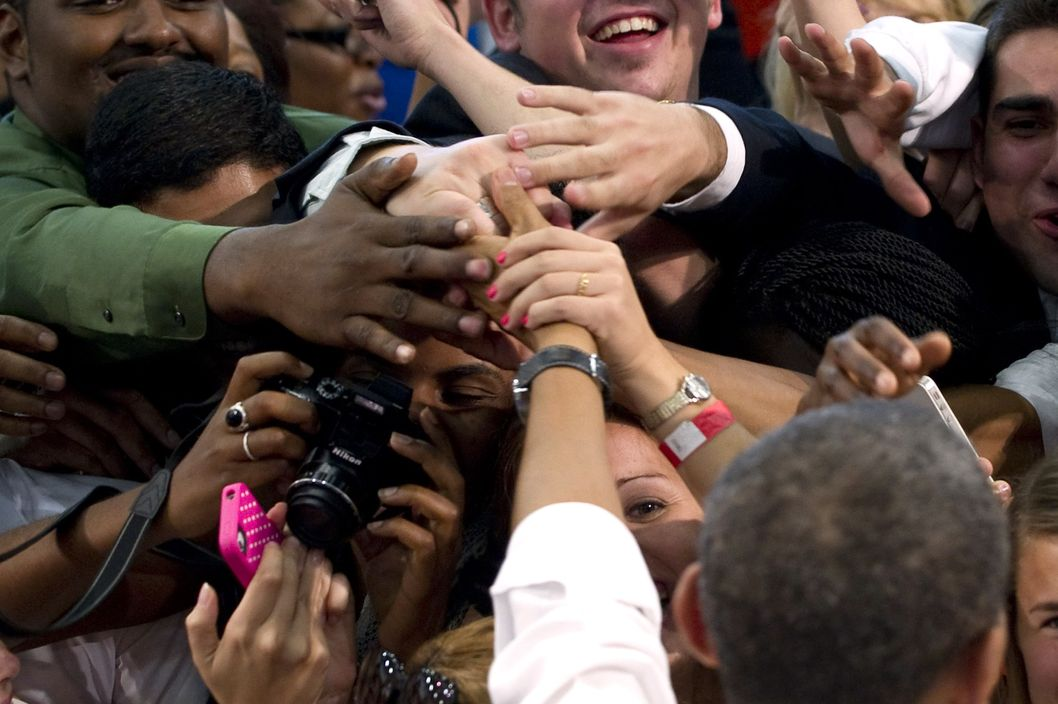 US President Barack Obama greets students after speaking on energy and the economy following a tour of the Industrial Assessment Center at the University of Miami