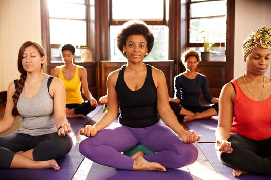 20 Oct 2012, Brooklyn, New York City, New York State, USA --- Women meditating in yoga class --- Image by ? Granger Wootz/Blend Images/Corbis