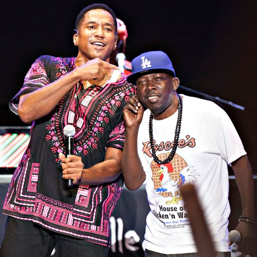 Phife Dawg (R) and Q-Tip of A Tribe Called Quest perform in Los Angeles on August 17, 2013 in Los Angeles, California.