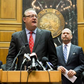 INDIANAPOLIS, IN - APRIL 2: Indiana Senate President Pro Tem David Long speaks as House Speaker Brian Bosma (R) looks on during a press conference about anti-discrimination safeguards added to the controversial Religious Freedom Restoration Act at the State Capitol April, 2, 2015 in Indianapolis, Indiana. The bill prompted a swift backlash nationwide with businesses and entertainers promising to boycott the state. (Photo by Aaron P. Bernstein/Getty Images)