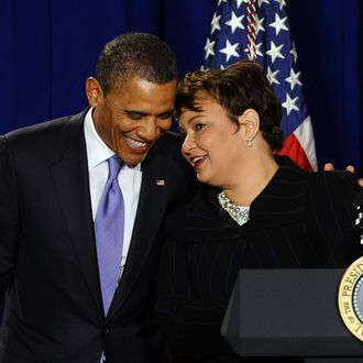 US President Barack Obama (L) listens to Environmental Protection Agency (EPA) administrator Lisa Jackson before speaking to EPA employees in Washington, DC, on January 10, 2012.