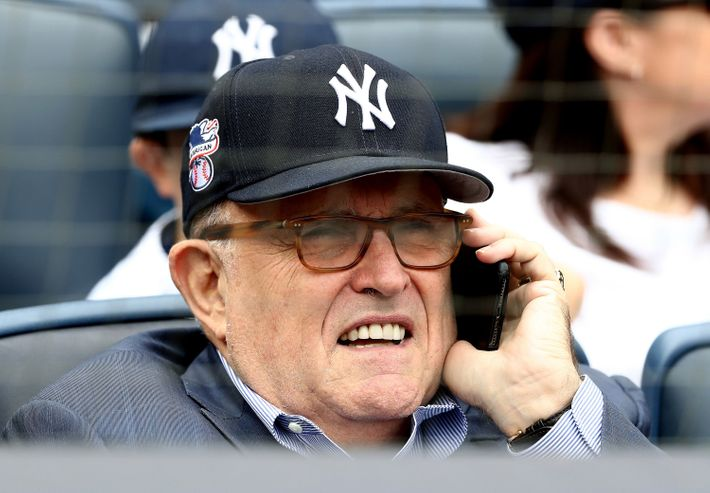 Rudy Giuliani wearing a Yankees cap and on the phone at Monday's Yankees game.