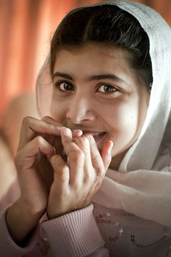 Malala Yousafzai, 12, lives in the Swat Valley with her family, pictured on March 26, 2009 in Peshawar, Pakistan. She wants to become a politician and is relieved that the schools have re-opened, but is scared that Taliban militants will forbid school for all girls after the 4th grade. In October 2012, aged 14, she was shot in the head by Taliban gunmen, but survived. The militants behind the attack, which was internationally condemned, claimed it was because she promoted secularism.