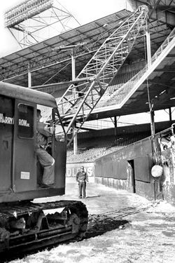 Ebbets Field being demolished by wrecking ball.