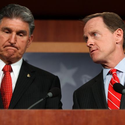 WASHINGTON, DC - APRIL 10:  Sen. Pat Toomey (R-PA) (R) and Sen. Joe Manchin (D-WV) speak to the press about background checks for gun purchases, in the U.S. Capitol building April 10, 2013 in Washington DC.  The pair is proposing a bipartisan compromise, a proposal to be voted on as an amendment that would expand background checks to firearms sales at gun shows and on the Internet. (Photo by Allison Shelley/Getty Images)