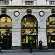 People walk past a branch of Banca Popolare di Milano bank on January 19, 2016 in Milan.