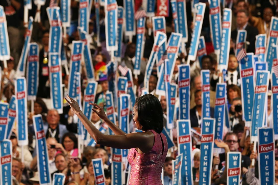 CHARLOTTE, NC - SEPTEMBER 04:  First lady Michelle Obama exits the stage after speaking during day one of the Democratic National Convention at Time Warner Cable Arena on September 4, 2012 in Charlotte, North Carolina. The DNC that will run through September 7, will nominate U.S. President Barack Obama as the Democratic presidential candidate.  (Photo by Justin Sullivan/Getty Images)