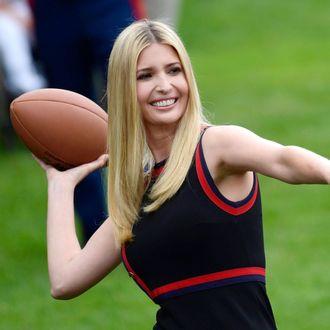 Ivanka Trump throwing a football.