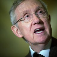 "Senate Majority Leader Harry Reid (D-NV) speaks to the press after the Democrats' weekly policy luncheon in the U.S. Capitol building March 6, 2012  in Washington, DC.  Reid criticized Senate Minority Leader Mitch McConnell's statement that the U.S. should use military force against Iran if the country develops nuclear weapons saying that lawmakers must be ""very, very cautious""."