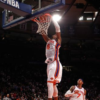 J.R. Smith #8 of the New York Knicks dunks in the first half against the Miami Heat in Game Three of the Eastern Conference Quarterfinals in the 2012 NBA Playoffs on May 3, 2012 at Madison Square Garden in New York City.
