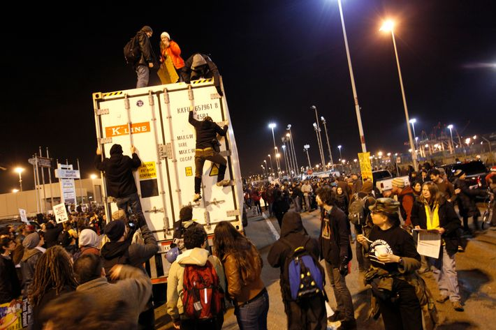 Occupy Wall Street protesters gather in front of a terminal gate of the Port of Oakland to try to shutdown the port as a part of the West Coast port blockage on December 12, 2011 in California. AFP Photo / Kimihiro Hoshino (Photo credit should read KIMIHIRO HOSHINO/AFP/Getty Images)