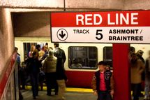 People entering and leaving the Red Line subway station in Boston, MA where the subway is known as the T.