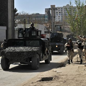 Afghan security forces arrive at the scene of an attack in Kabul on April 15, 2012. Explosions and gunfire rocked the Afghan capital Kabul on April 15, as suicide bombers struck across Afghanistan in coordinated attacks claimed by Taliban insurgents as the start of a spring offensive. AFP PHOTO/Massoud HOSSAINI (Photo credit should read MASSOUD HOSSAINI/AFP/Getty Images)