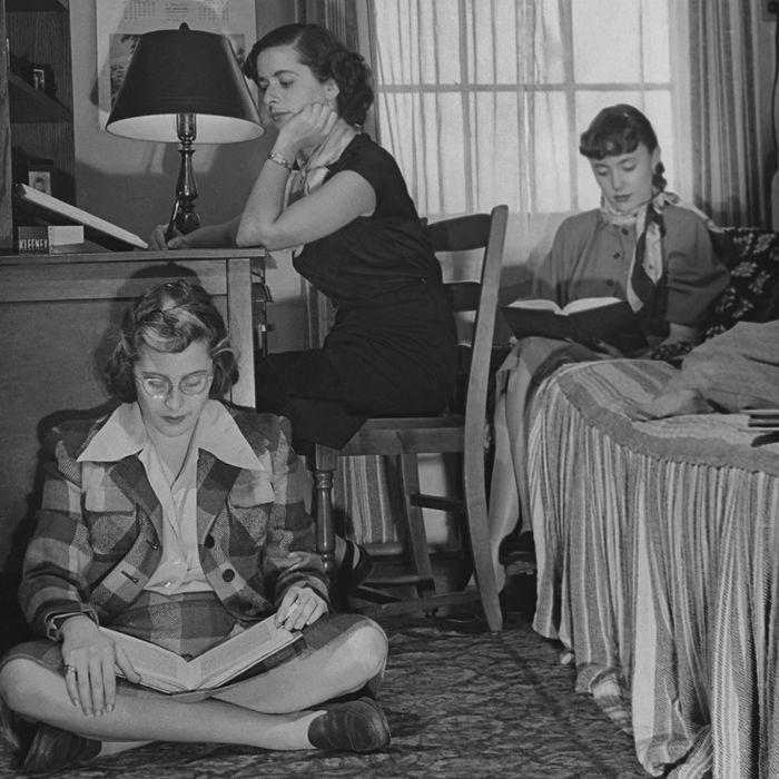 Four women in a 1950s dorm.