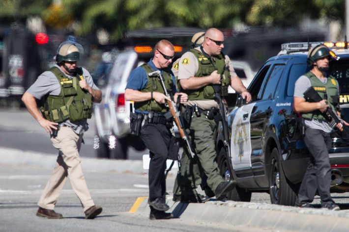 Police offices in SWAT gear secure the scene where a mass shooting occurred at the Inland Regional Center on December 2, 2105 in San Bernardino, California.